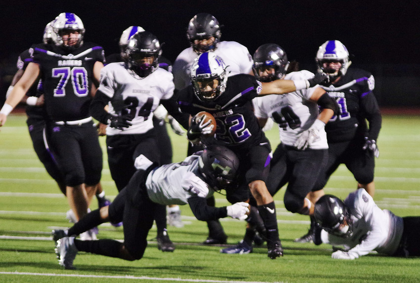 Cedar Ridge High School running back Deuce Vaughn (22) runs up the middle against Hendrickson at Dragon Field on October 12 2018.
