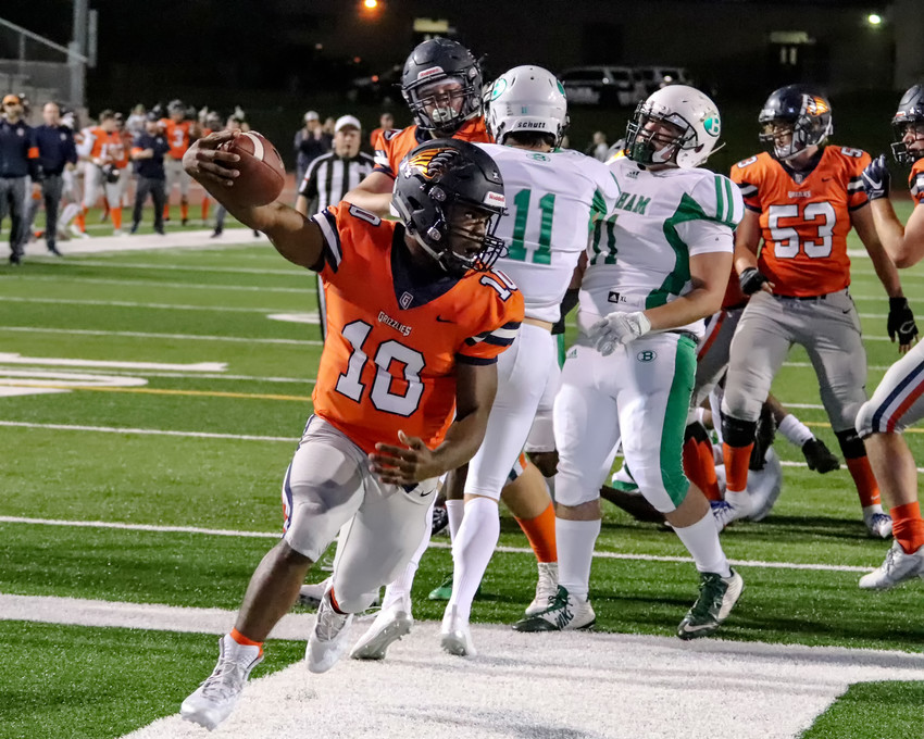 Lamont Slade and Glenn beat Brenham 21-7 Friday night at Bible Stadium to clinch the top spot in District 13-5A Division II.