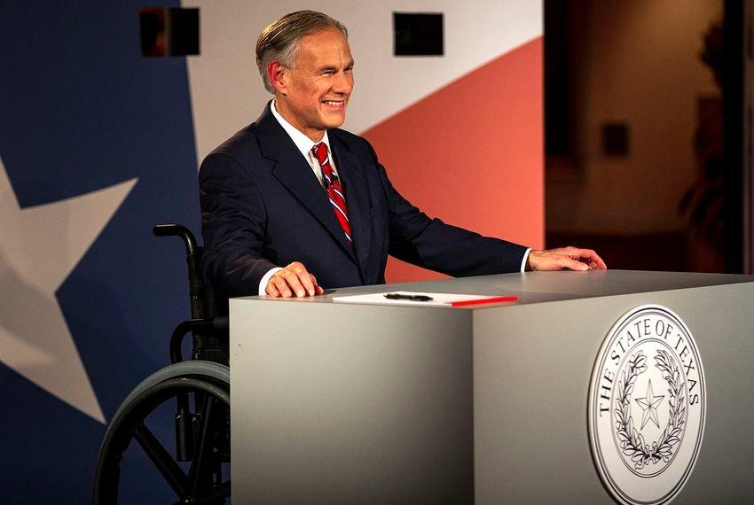 Texas Governor Greg Abbott smiles before a gubernatorial debate against his Democratic challenger Lupe Valdez at the LBJ Library in Austin on Friday, Sept. 28, 2018.
