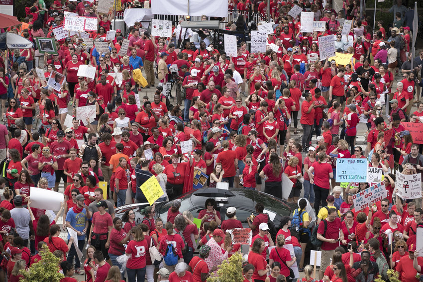 Thousands of North Carolina teachers descend upon the entrance to the Legislature to lobby for better pay and education funding on May 16, 2018, in Raleigh, N.C.