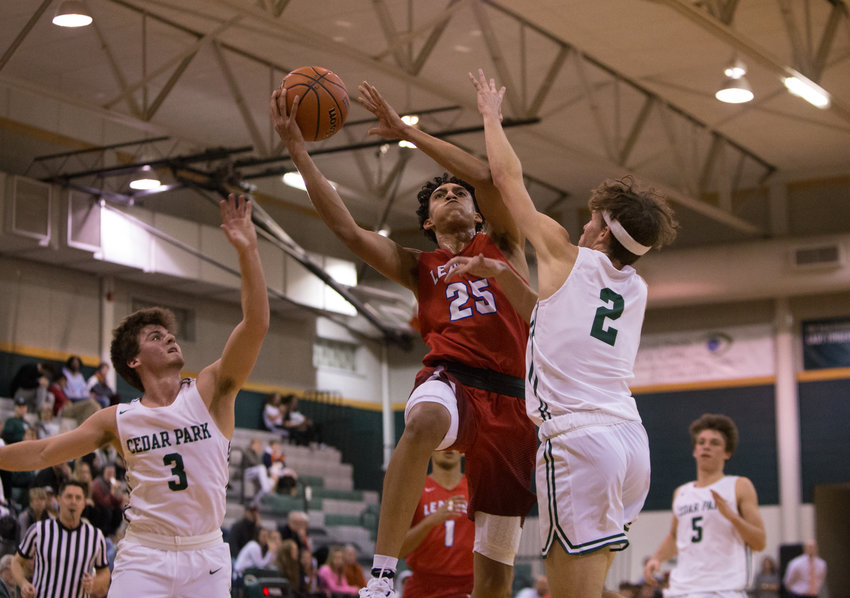 Leander Lions guard Noah Robledo (25) goes up for a shot during a high school basketball game between Cedar Park and Leander at Cedar Park High School on Tuesday, Nov. 13, 2018 in Cedar Park, TX.