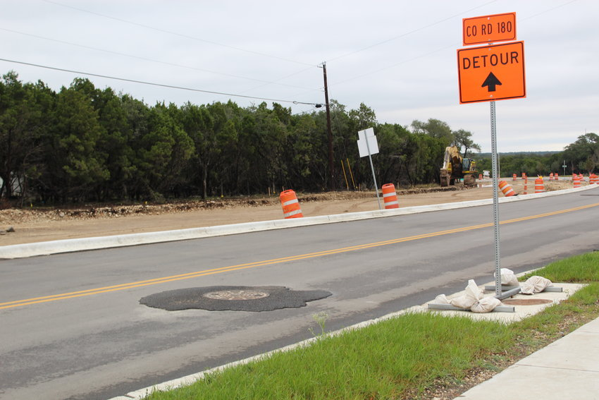 The manhole covers appear to be elevated along the portion of New Hope Drive under construction, but the City of Cedar Park says the final layer of asphalt hasn't been laid yet and will resolve the issue.