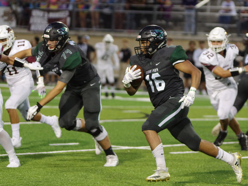 Cedar Park High School running back Jonathon Stockwell (16) runs along the outside against Rouse High School at Gupton Stadium on September 28, 2019.