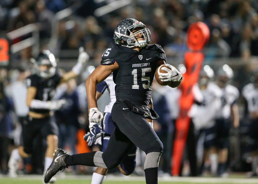 Vandegrift Vipers senior running back Isaiah Smallwood (15) carries the ball into the end zone on a touchdown run in the second quarter of a high school football game between Vandegrift and Tomball Memorial at Monroe Stadium on Friday, Nov. 16, 2018 in Austin, TX.