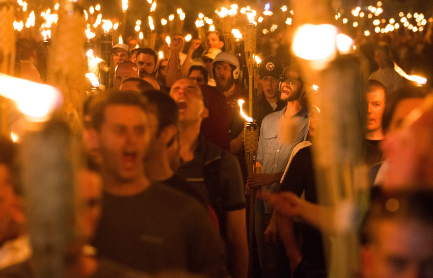 """Neo-Nazis, alt-Right, and white supremacists march the night before the """"Unite the Right"""" rally, on Friday, Aug. 11, 2017 through the University of Virginia in Charlottesville, Va. (Zach D Roberts/NurPhoto/Zuma Press/TNS)"""