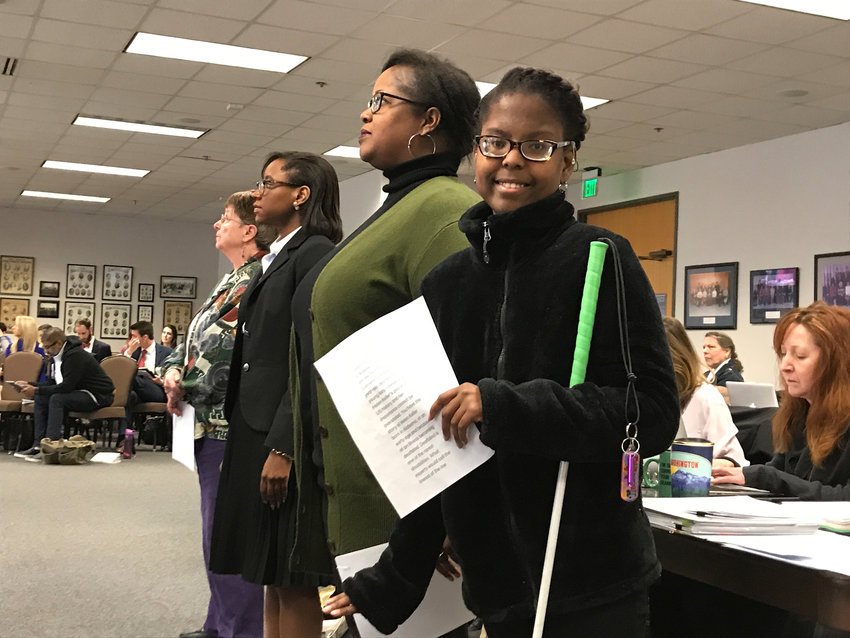 Gabrielle Caldwell, a 17-year-old deaf-blind student, poses with her mother Robbie Caldwell at the Texas State Board of Education last month in Austin. The Caldwells want Helen Keller to remain in the Texas Essential Knowledge and Skills, or TEKS, for social studies.