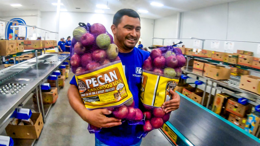PEC Regional Operations Supervisor Thomas Castillo lends a hand at PEC's second annual volunteer day with the Central Texas Food Bank.