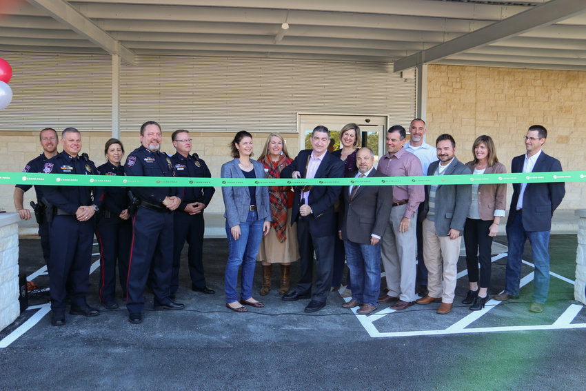 CPPD Police department and city staff members cut the ribbon to unveil the Cedar Park Police Department expansion at 911 Quest Pkwy.
