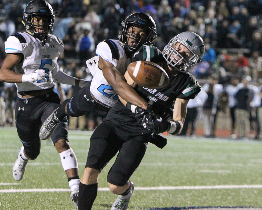 Shadow Creek Sharks defensive back Jalen Rideau (21) breaks up a pass intended for Cedar Park Timberwolves Carson Neel (1) in the end zone during a high school football playoff game between Cedar Park and Shadow Creek at Merrill Green Stadium on Friday, Nov. 23, 2018 in Bryan, TX.