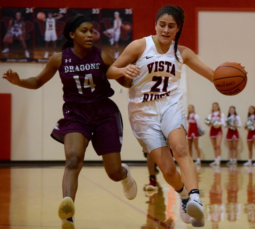 Victoria Baker, right, scored 10 points and Vista Ridge beat Round Rock 69-46 in the first district game of the season for the Lady Rangers Tuesday night at home.