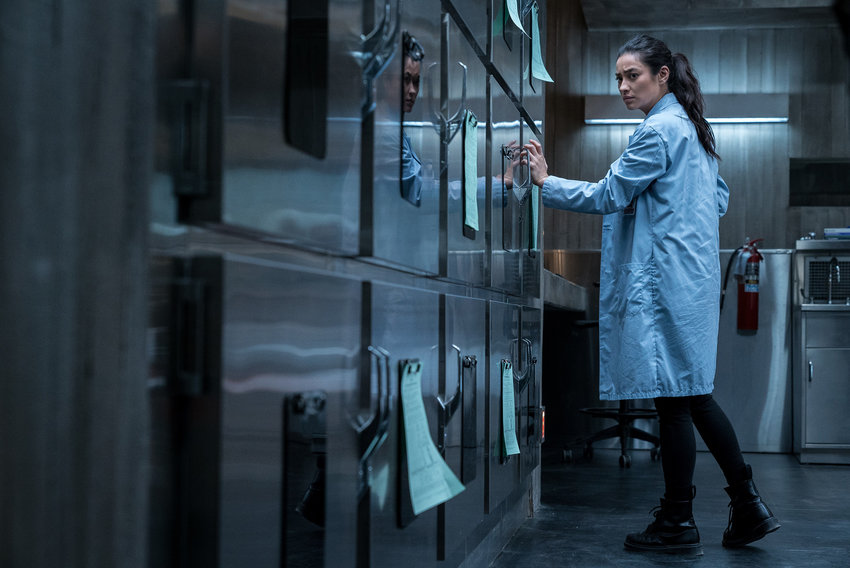 """Megan (Shay Mitchell) realizes that something is not right in Hannah Grace's cadaver drawer in Screen Gems' """"The Posession of Hannah Grace."""" (Sony Pictures/TNS)"""
