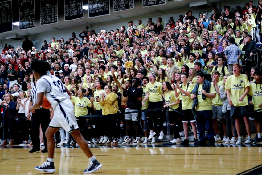 The Vista Ridge student section reacts to the Rangers game-tying basket with two seconds left in regulation. Students were wearing yellow #LLM shirts to honor Ranger player Myles Hutcheson, who passed away Monday.