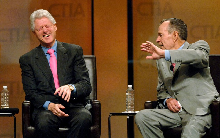 Former president George H.W. Bush jokes with former president Bill Clinton in 2007. George H.W. Bush died Friday, Nov. 30, 2018, at the age of 94.