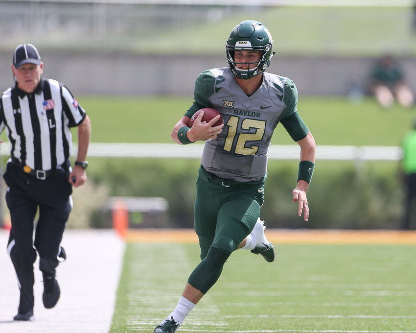 Baylor quarterback Charlie Brewer (quarterback Charlie Brewer threw for 384 yards and two touchdowns and had the first 100-yard rushing game of his career, going for 108 yards and a touchdown in the Bears' Texas Bowl win over Vanderbilt on Saturday.