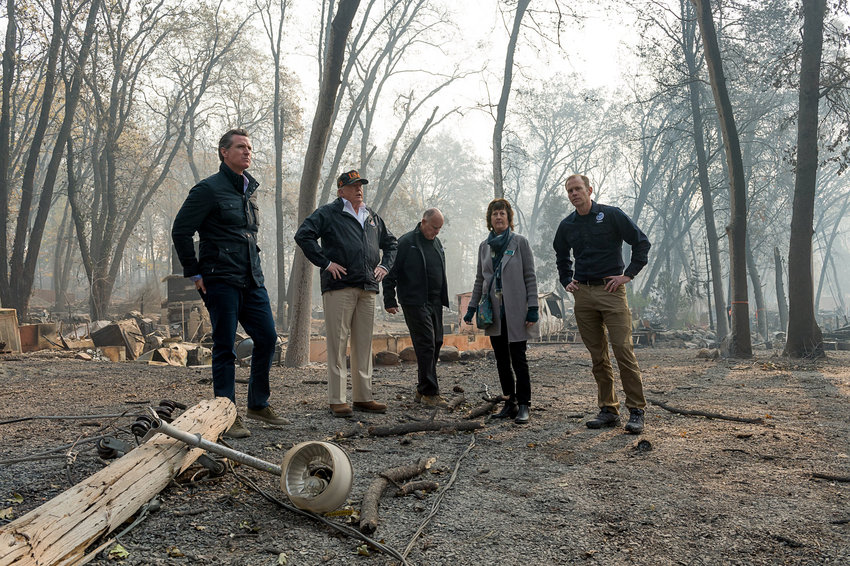 California Gov. Gavin Newson, FEMA Director Brock Long, President Donald Trump, Paradise mayor Jody Jones and former California Gov. Jerry Brown tour the Skyway Villa Mobile Home and RV Park last November.
