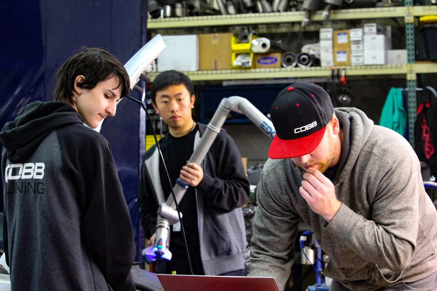 Vandegrift High School seniors Phillip Branca and Alex Tan gain hands-on experience in the automotive technology field  from COBB Tuning's Paul Geyman during Leander ISD's annual COOL Week program.