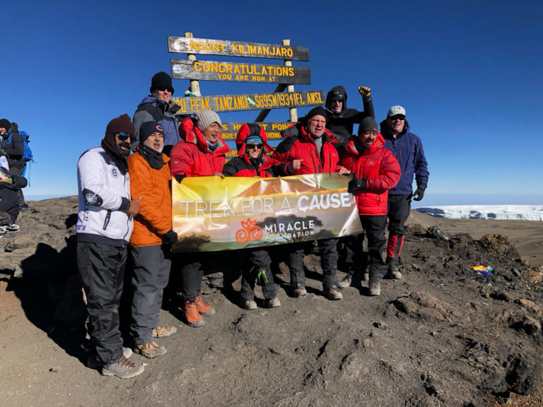 David Lesniak and his group hiked more than eight hours in order to reach the summit of Mount Kilimanjaro, the highest peak in Africa at 19,341 ft.