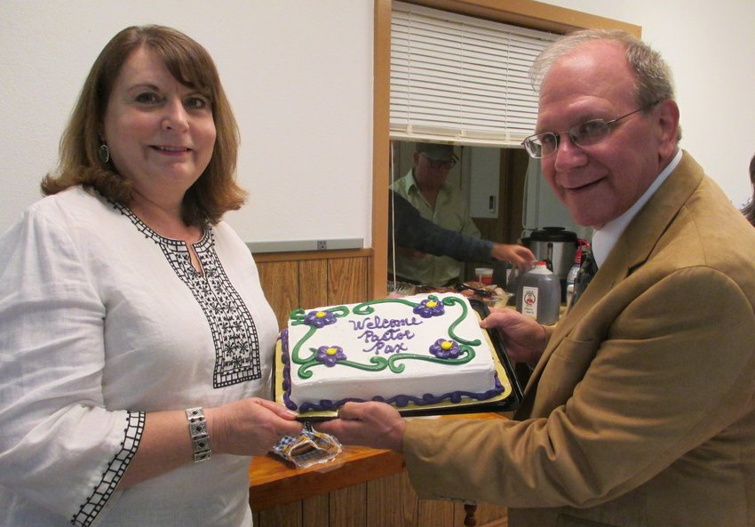 New pastor Edmund Pax (right) is pictured with his wife, Diane, during a welcome barbecue celebration.