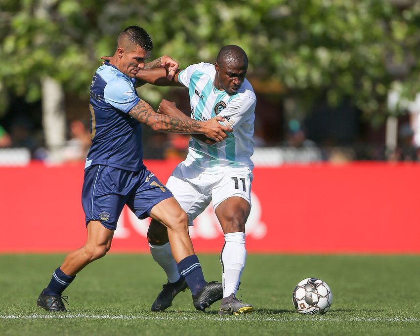 Austin Bold FC forward Isaac Promise (11) and El Paso Locomotive FC midfielder Sebastián Contreras (10) for possession during a United Soccer League game between Austin Bold FC and El Paso Locomotive FC on April 21, 2019 at Bold Stadium in Austin, Texas.