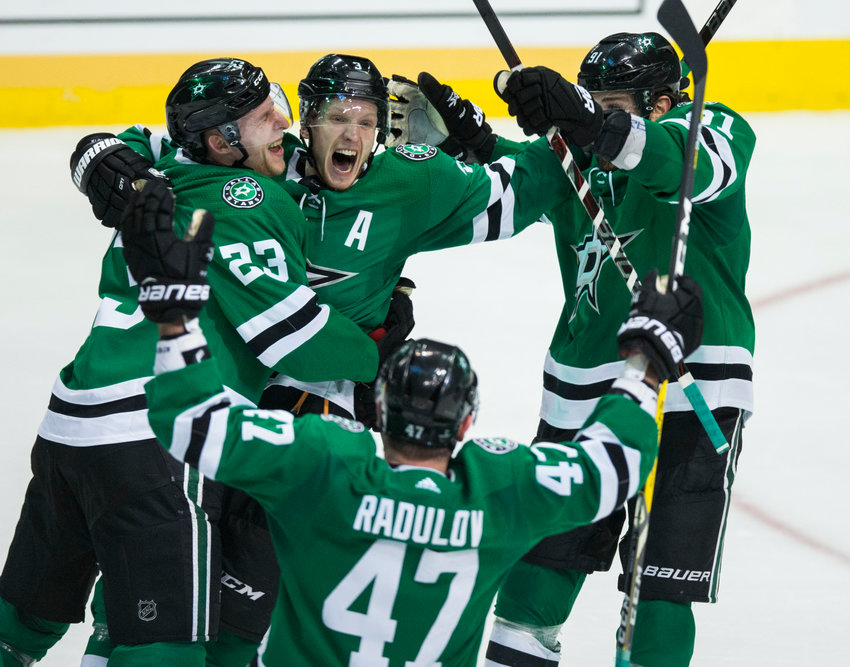 Dallas Stars defenseman John Klingberg (3) celebrates with Esa Lindell (23), Tyler Seguin (91) and Alexander Radulov (47) after scoring the game winner during overtime of Game 6 of the first round of Stanley Cup Playoffs between the Dallas Stars and the Nashville Predators on Monday, April 22, 2019 at American Airlines Center in Dallas. The Dallas Stars won the game 3-2, and won the series. They will advance to the conference finals to play the St. Louis Blues.