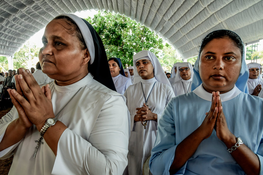 Nuns pray at a religious mass for the victims of the blast at St Sabestian Church on April 23, 2019 in Negambo, Sri Lanka.