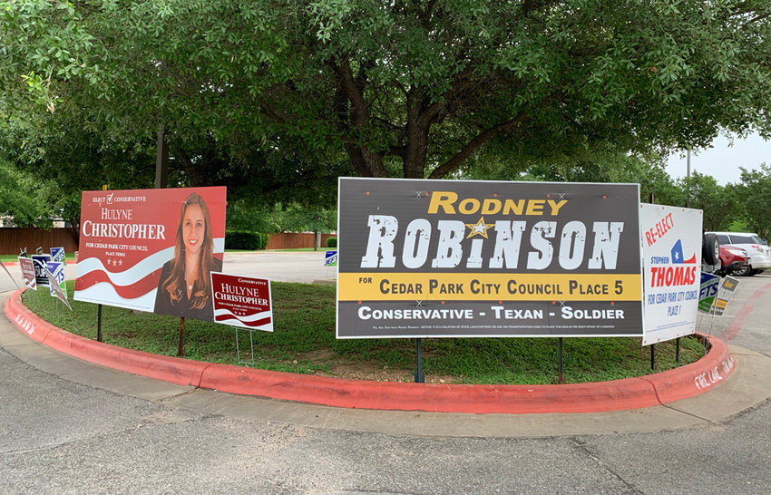 Campaign signs line the parking lot at the Cedar Park Public Library Tuesday, April 29, the final day of early voting. Election Day is Saturday, May 4.