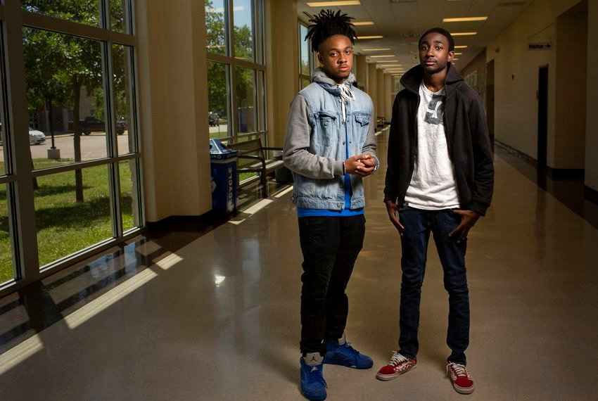 Round Rock High School senior Ahmir Johnson (left) and junior Addison Savors are among students of color who fear an expansion of the state's school marshal program will impact them more than others.
