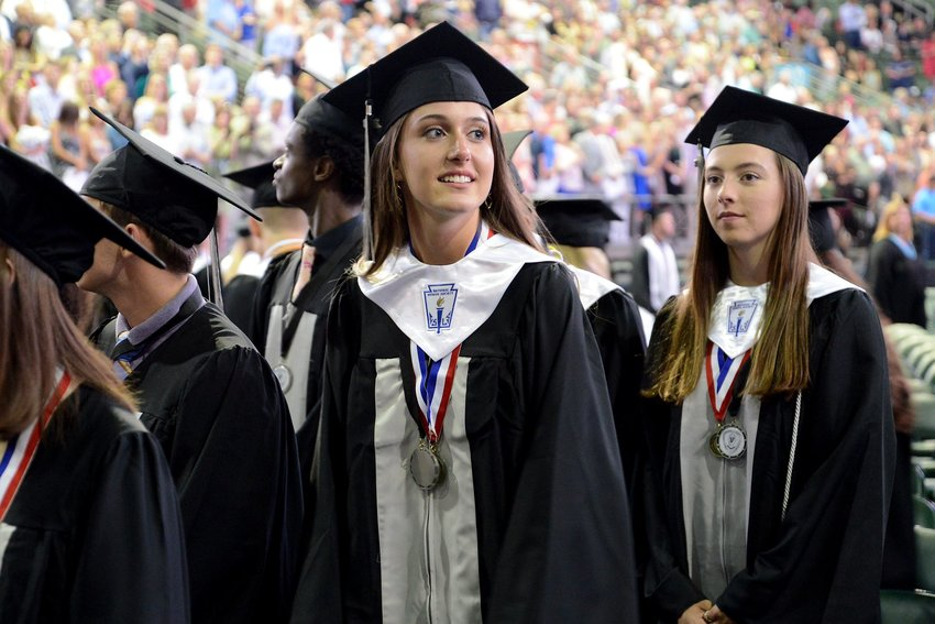A Vandegrift High School senior looks into the crowd at the H-E-B Center at Cedar Park during the school's 2018 graduation ceremony.