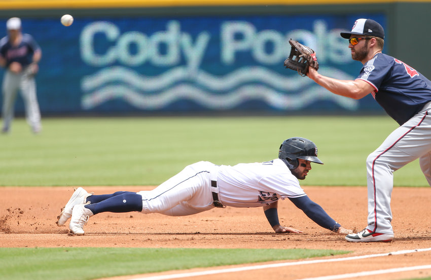 Round Rock Express shortstop Alex De Goti (9) returns to first base ahead of the throw to Nashville Sounds first baseman Matt Davidson (24) during a Minor League Baseball game between the Round Rock Express and the Nashville Sounds on Sunday, May 19, 2019 at Dell Diamond in Round Rock, Texas.