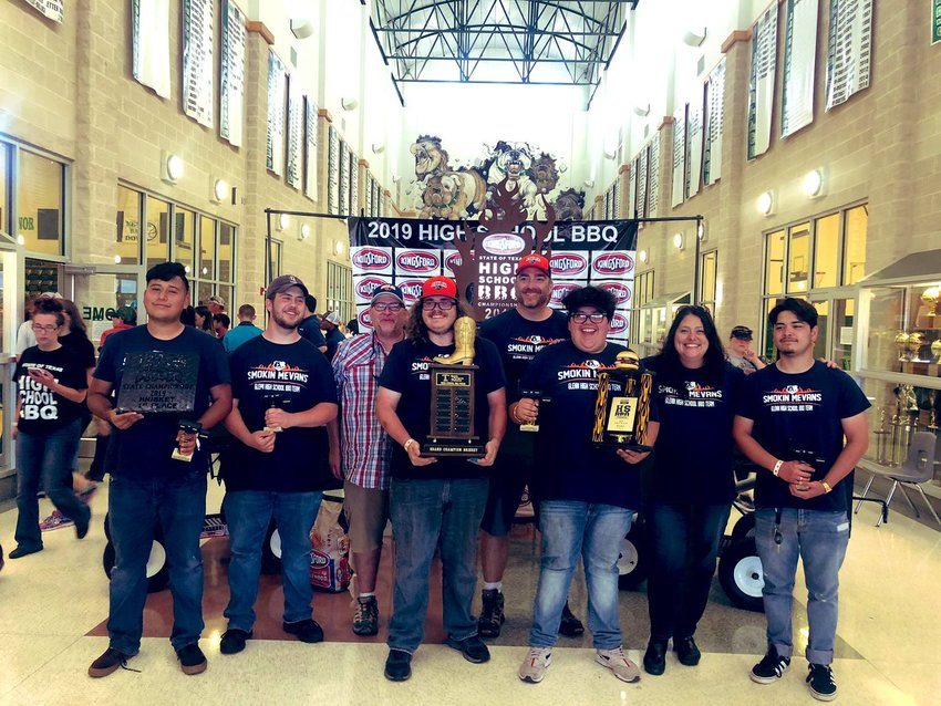 The Glenn High School Smokin' Mavens team gathers for a group photo after winning first place in the State High School BBQ Championship on May 4, 2019.
