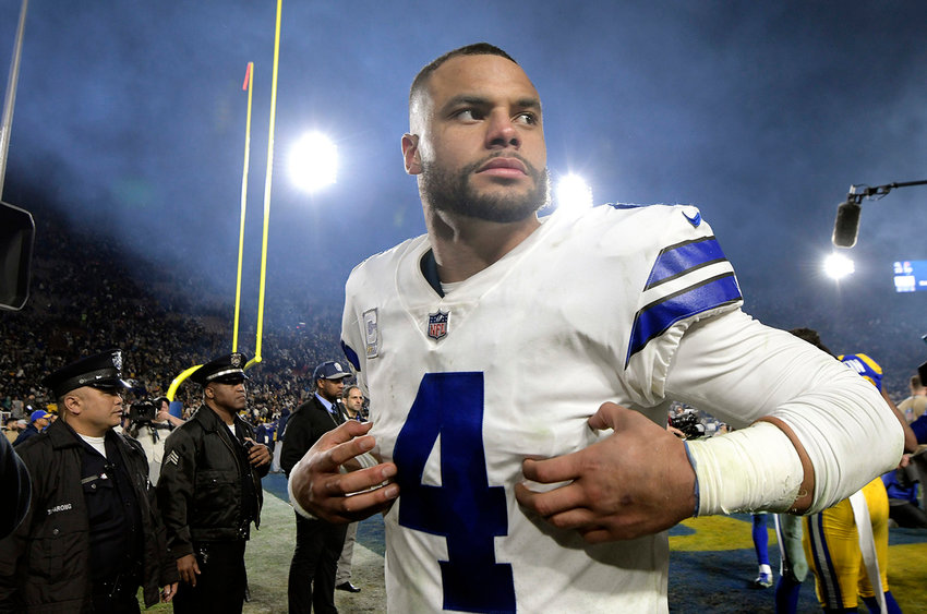 Dallas Cowboys quarterback Dak Prescott (4) walks off the field after a 30-22 loss against the Los Angeles Rams in the NFL Divisional Round at the Los Angeles Memorial Coliseum on January 12, 2019.