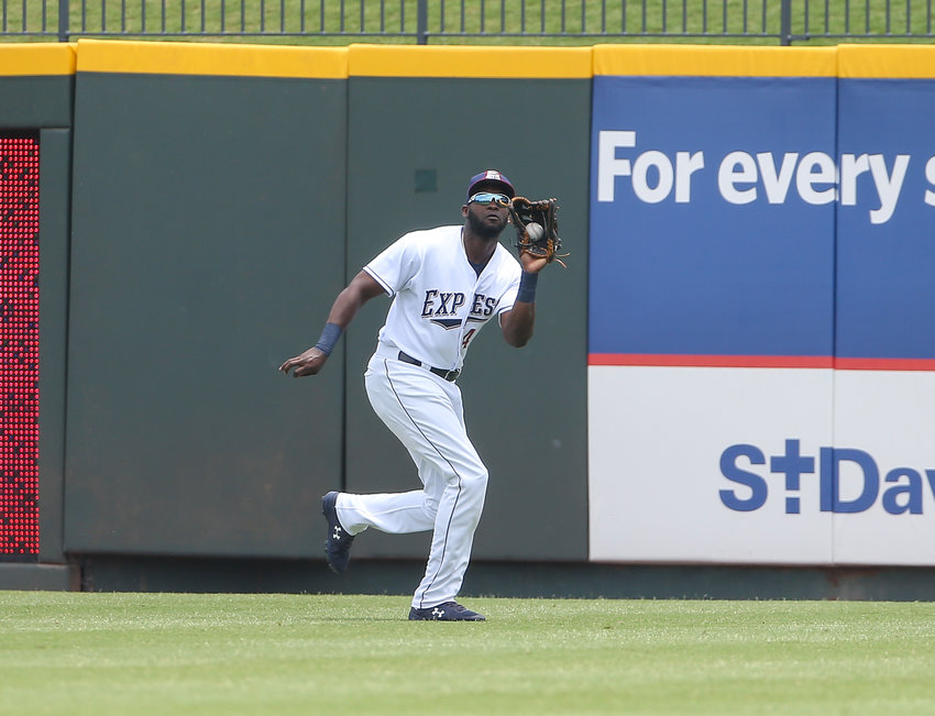 Round Rock Express left fielder Yordan Alvarez (45) makes a catch during a Minor League Baseball game between the Round Rock Express and the Nashville Sounds on Sunday, May 19, 2019 at Dell Diamond in Round Rock, Texas.