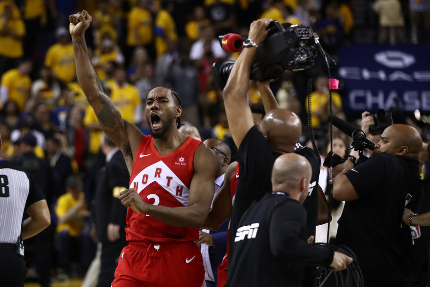 Kawhi Leonard of the Toronto Raptors celebrates his team's 114-110 win against the Golden State Warriors in Game 6 to capture the NBA championship at ORACLE Arena in Oakland, Calif., on Thursday, June 13, 2019.