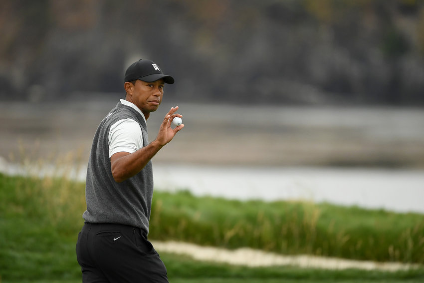 Tiger Woods waves to the crowd during the first round of the U.S. Open at Pebble Beach Golf Links on Thursday, June 13, 2019, in Pebble Beach, Calif.
