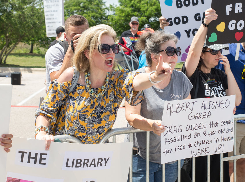 Tracy Shannon, leader of MassResistance Houston, yells across the barricade at the Leander Family Pride and Story Time event, formerly a Drag Queen Story Hour, on June 15, 2019 at the Leander Public Library in Leander, Texas.