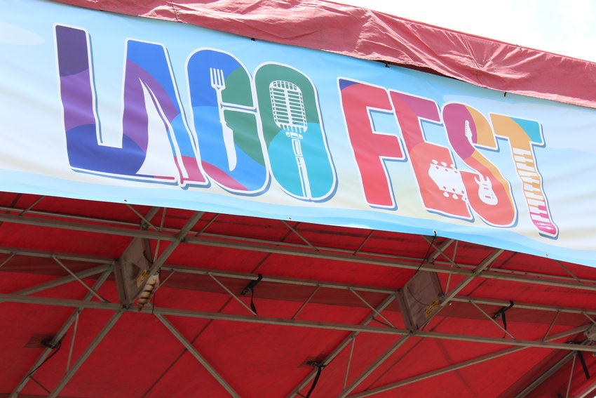 A banner displayed off the roof of the stage where musicians played at LagoFest on June 16, 2019.