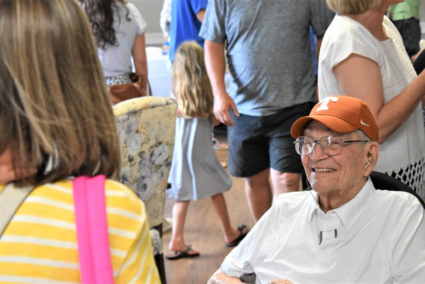 George Atkinson greets guests during his party last Wednesday. Atkinson is a World War II veteran and University of Texas at Austin graduate.