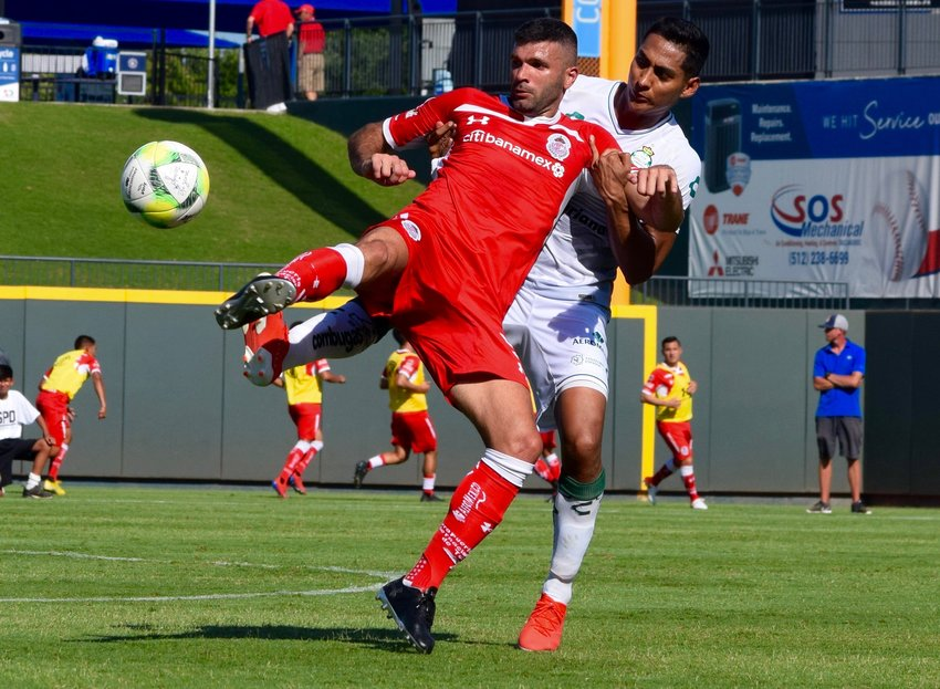 Emmanuel Gigliotti, right, and Toluca beat Santos Laguna 4-2 in penalties in a Liga MX friendly Sunday at Dell Diamond in Round Rock.