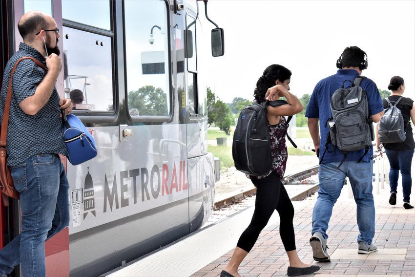 Commuters disembark at the MetroRail station in Leander. The City of Leander is considering a proposal to withdraw from the regional public transportation system, which it has been a member of since 1985.