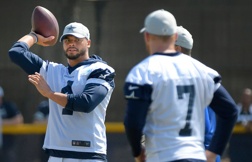 Dallas Cowboys quarterbacks Dak Prescott (4) and Cooper Rush (7) play catch during training camp in Oxnard, Calif., on Aug. 7, 2018.