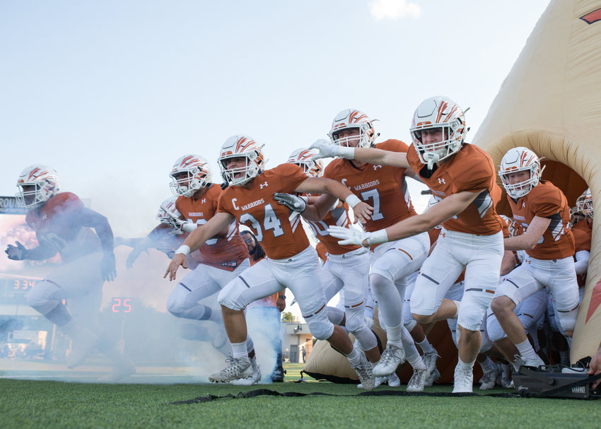 The Westwood Warriors take the field for a high school football game between the Westwood Warriors and the Lehman Lobos at Kelly Reeves Stadium in Round Rock, Texas, on Thursday, August 31, 2017.