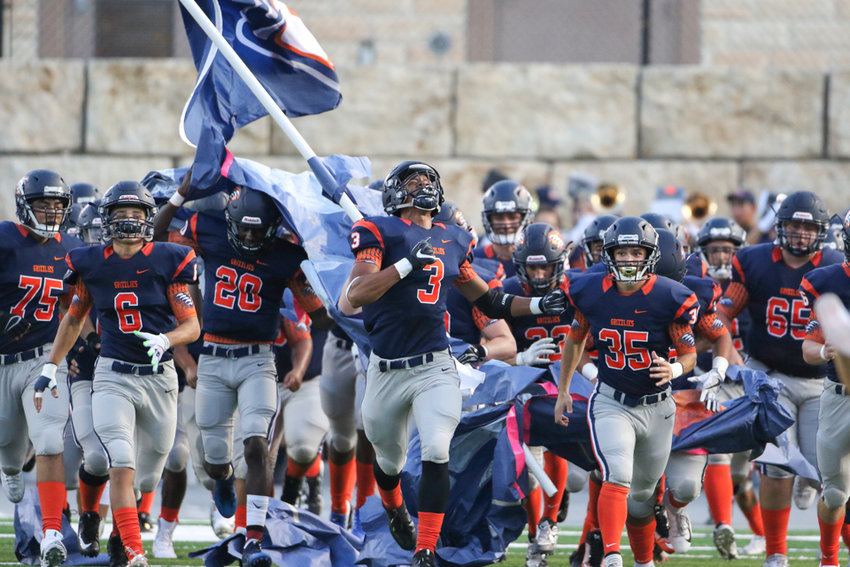 The Glenn Grizzlies take the field for a high school football game between Glenn and McNeil on Friday, Sept 7, 2018 in Cedar Park, Texas.