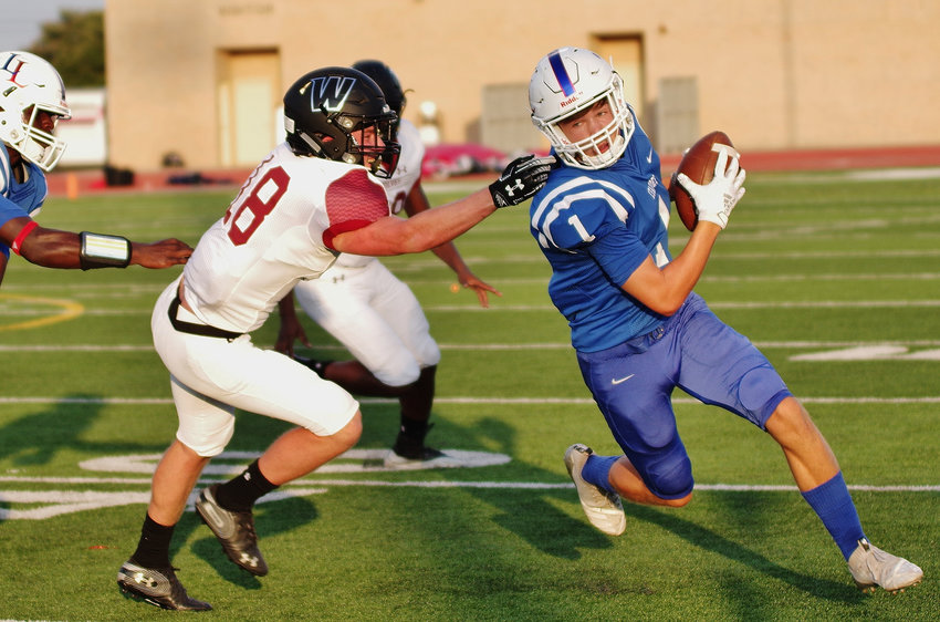 Leander High School wide receiver Aiden Perrott (1) runs along the sideline against the Weiss Wolves at Bible Stadium, Leander, Texas on August 30, 2019.
