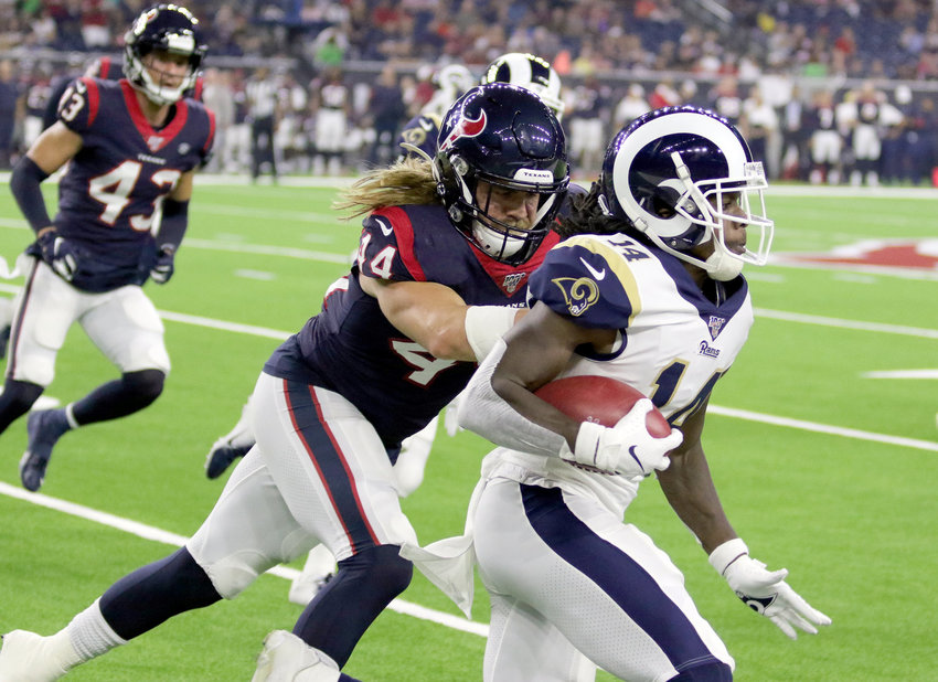 Cullen Gillaspia (44) of the Houston Texans runs Los Angeles Rams receiver Nsimba Webster out of bounds during Thursday night's preseason game at NRG Stadium. Gillaspia is from Katy and is one of several players waiting to see if the make the cut to stay on the Texans 53-man roster. The Rams beat the Texans 22-10.