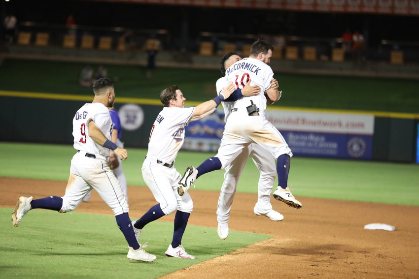 Chas McCormick celebrates with teammates after hitting a walk-off single to help the Express beat the Iowa Cubs in Game 1 of the PCL Semifinals Wednesday night at Dell Diamond.