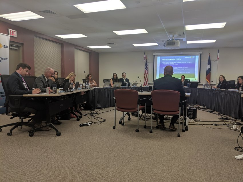 Leander Independent School District Chief of Staff Matt Smith discusses the proposed three-tier bell schedule with the LISD Board of trustees on Thursday.