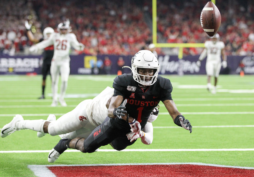 Houston Cougars wide receiver Bryson Smith (1) drops a pass in the end zone after Washington State Cougars cornerback Marcus Strong (4) is called for pass interference during an NCAA football game between the Houston Cougars and the Washington State Cougars at NRG Stadium in Houston, Texas, on September 13, 2019.