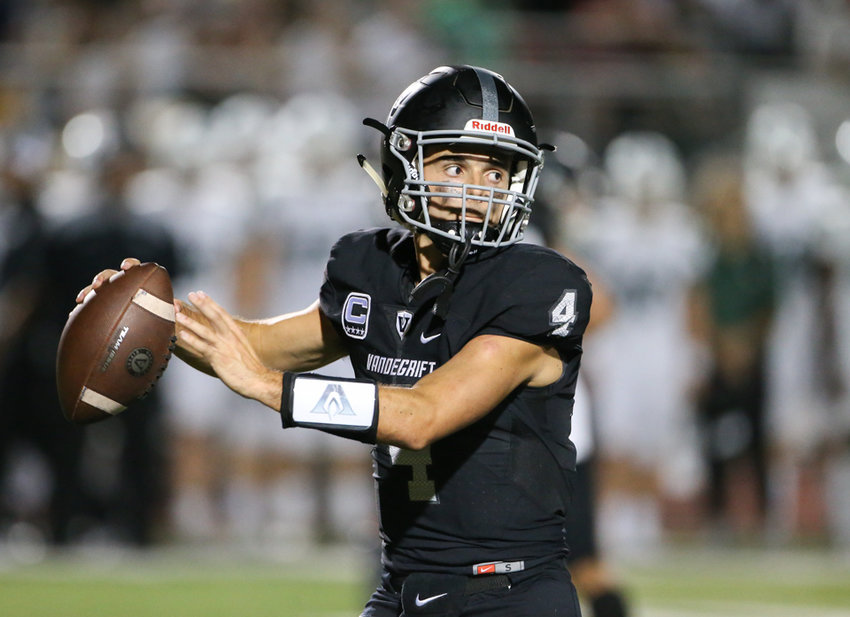 Vandegrift Vipers quarterback Dru Dawson looks to pass during a high school football game between Vandegrift and Cedar Park at Monroe Stadium in Austin, Texas on August 30, 2019.