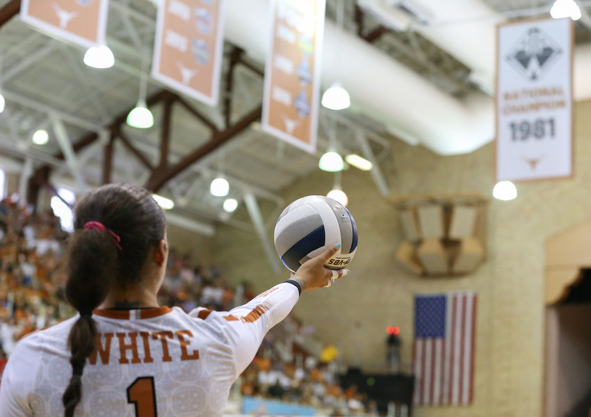 Texas Longhorns MICAYA WHITE (1) prepares to serve during an NCAA volleyball match between the University of Texas and the University of Southern California at Gregory Gymnasium in Austin, Texas on September 1, 2019.