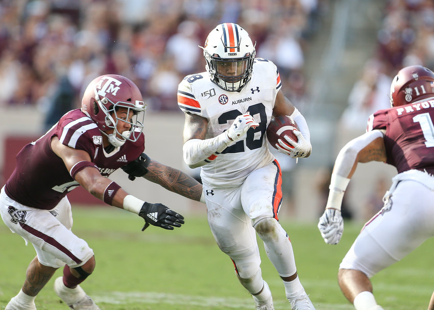 Auburn Tigers running back JaTarvious Whitlow (28) carries the ball during an NCAA football game between Texas A&M and Auburn at Kyle Field in College Station, Texas, on September 21, 2019.